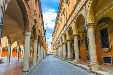 Typical italian street, buildings with columns, Palazzo Poggi museum, Accademia Delle Scienze Since Academy, University of Bologna in old historical city centre of Bologna, Emilia-Romagna, Italy