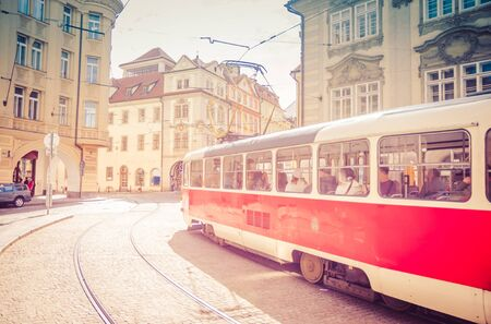 Typical old retro vintage tram on tracks near tram stop in the streets of Prague city in Lesser Town (Mala Strana) district, Bohemia, Czech Republic. Public transport concept.