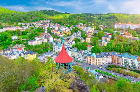Karlovy Vary (Carlsbad) historical city centre top aerial view with colorful beautiful buildings, Slavkov Forest hills with green trees and Deer Jump Jeleni Skok Lookout, West Bohemia, Czech Republic Reklamní fotografie