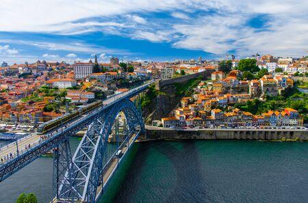 Portugal Porto panorama, The Eiffel Bridge, Ponte Dom Luis, Bridge Ponti Di Don Luis, Douro river, panoramic view of Porto city, Porto in June, white clouds at summer blue sky in Porto