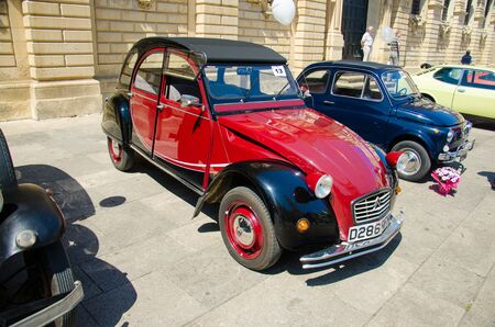 Lecce, Italy - April 23, 2016: Front view of vintage classic retro red automobile car parked in a street of Lecce city, Puglia Apulia region, Southern Italy