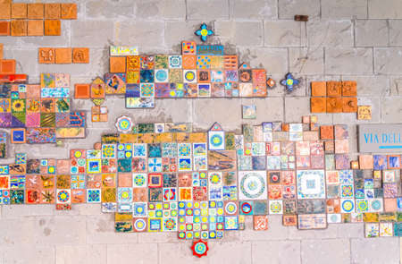 Riomaggiore, Italy, September 9, 2018: decorative mosaic tiles on wall in village of National park Cinque Terre, Liguria, Italy