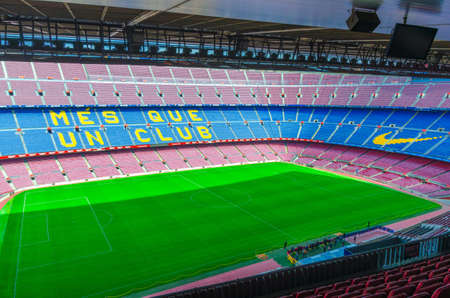 Barcelona, Spain, March 14, 2019: Camp Nou is the home stadium of football club Barcelona, the largest stadium in Spain. Top aerial view of tribunes stands and green grass field from commentary box.