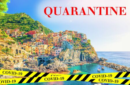 Quarantine in Italy. Manarola village in National park Cinque Terre. No travel and lockdown concept. Coronavirus outbreak Covid-19 pandemic concept. Canceled tourist vacation. Yellow black tape.