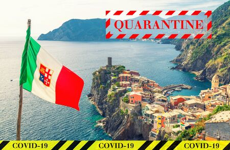 Quarantine in Italy. Vernazza village in National park Cinque Terre. No travel and lockdown concept. Coronavirus outbreak Covid-19 pandemic concept. Canceled tourist vacation. Yellow black tape. Stock Photo