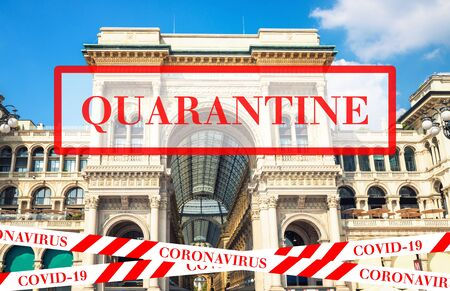 Quarantine in Italy. Gallery Vittorio Emanuele II Galleria mall in Milan. No travel and lockdown concept. Coronavirus outbreak Covid-19 pandemic concept. Canceled tourist vacation. Barrier tape.