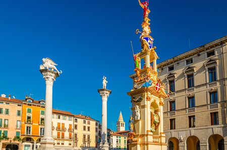 Columns with winged lion and statues in Piazza dei Signori square, old historical city centre of Vicenza city, Veneto region, Italy