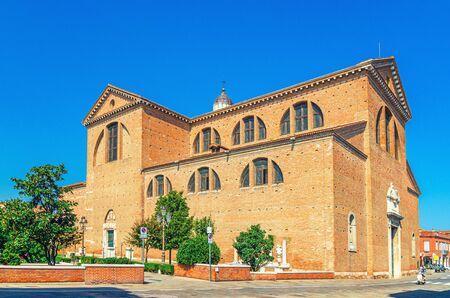 Cathedral Santa Maria Assunta Duomo Roman catholic church in Chioggia town historical centre, blue sky background in summer day, Veneto Region, Northern Italy