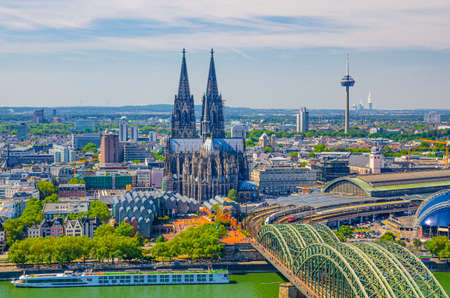 Aerial view of Cologne cityscape of historical city centre with Cologne Cathedral, central railway station Hauptbahnhof and Hohenzollern Bridge across Rhine river, North Rhine-Westphalia, Germany