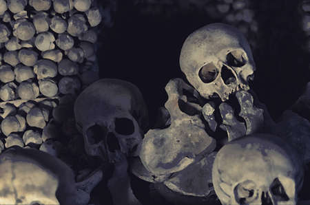 Watercolor drawing of Human bones and skulls. Pile of skulls. Skulls collection. Symbol of death, fear and evil. Kostnice Church in Kutna Hora. Фото со стока