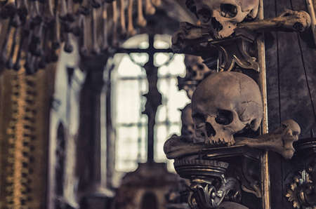 Watercolor drawing of Close-up human scull with bone in mouth and crucifixion of Jesus Christ in window background. Decoration by human scull and bones. Kostnice Church Фото со стока