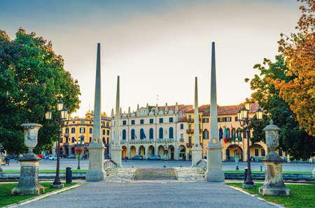 Padua cityscape with statues near bridge across small canal on Piazza Prato della Valle square in historical city centre, Padova town, Veneto Region, Italy