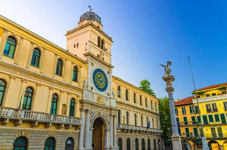 Torre dellOrologio clock tower building with astronomical clock in Piazza Plaza Dei Signori square in Padua historical city centre, twilight evening view, Padova town, Veneto Region, Italy