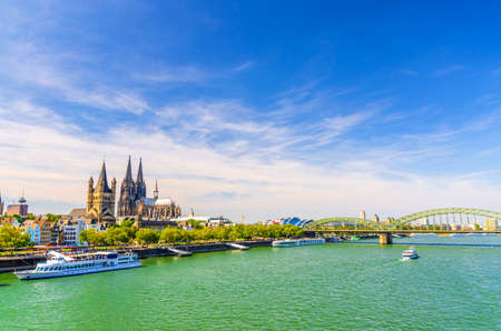 Cologne cityscape of historical city centre with Cologne Cathedral and Great Saint Martin Roman Catholic Church buildings, Hohenzollern Bridge across Rhine river, North Rhine-Westphalia, Germany