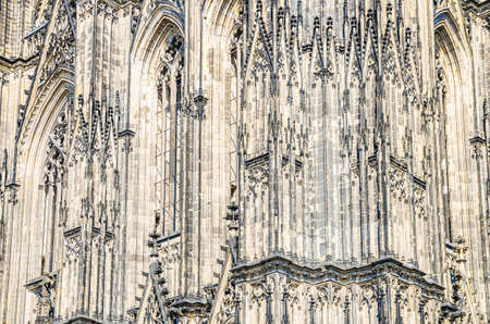 Close-up view of Cologne Cathedral Catholic Church gothic style building wall facade with ornaments, moldings stucco work and stained glass windows, North Rhine-Westphalia, Germany Stok Fotoğraf