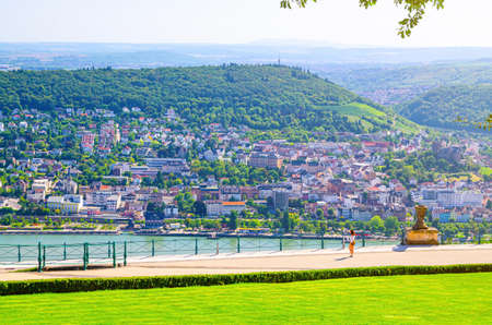 Rochusberg mountain hill and Bingen am Rhein town, aerial view from platform in forest on Niederwald broad hill on right bank of Rhine river, Rhineland-Palatinate and Hesse states, Germany