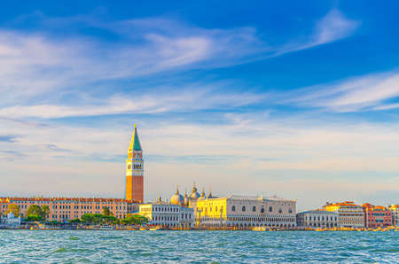Venice cityscape with San Marco basin of Venetian lagoon water, Procuratie Vecchie, Campanile bell tower, Biblioteca Marciana Library and Doges Palace Palazzo Ducale building, Veneto Region, Italy