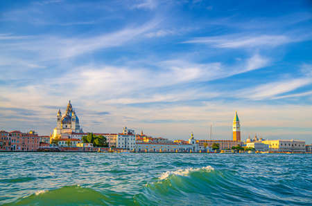 Venice cityscape with San Marco basin of Venetian lagoon water, Santa Maria della Salute church, Campanile bell tower and Doge's Palace Palazzo Ducale building, Veneto Region, Italy