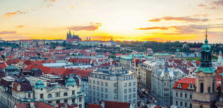 Panorama of Prague Old Town historical center with Prague Castle, St. Vitus Cathedral in Hradcany district background, sunset evening view. Aerial panoramic view of Prague city, Czech Republic