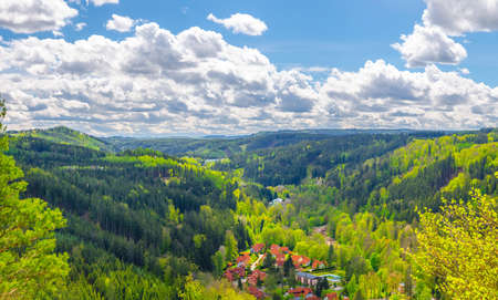 Slavkov Forest aerial panoramic view with small village, mountains, green hills and trees near Karlsbad town. Panorama of Karlovy Vary district, West Bohemia, Czech Republic Stock Photo