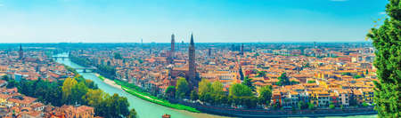 Panorama of Verona historical city center, bridges across Adige river, Basilica di Santa Anastasia, medieval buildings with red tiled roofs, Veneto Region, Italy. Panoramic view of Verona cityscape