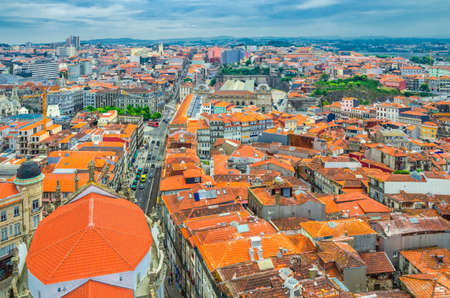 Aerial panoramic view of Porto Oporto city historical centre with red tiled roof typical buildings, Norte or Northern Portugal