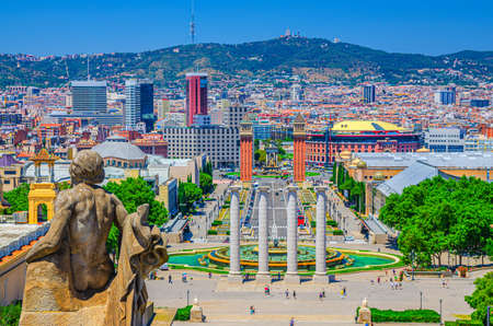 Cityscape of Barcelona with aerial view of Placa d'Espanya or Spain square with Torres Venecianes Venetian towers, Montju c fountain and Four Columns Les Quatre Columnes, Tibidabo hill background