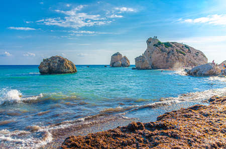 Aphrodite Beach with Stone Rocks in Aphrodite bay of Mediterranean sea water, blue sky in sunny day background, Petra tu Romiou, Cyprus
