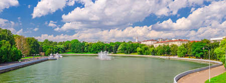 Panorama of Minsk cityscape with Svislach Svislac river embankment Janka Kupala Park and General Headquarters building in historical center blue sky white clouds, Republic of Belarus