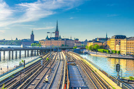 Cityscape of Stockholm historical city center with Riddarholmen island Church spires, City Hall Stadshuset tower, bridge over Lake Malaren in Gamla Stan and railway subway tracks, Sweden 免版税图像