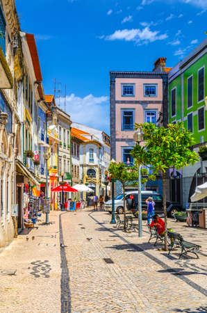 Aveiro, Portugal, June 13, 2017: typical colorful buildings on square in Aveiro city historical center in sunny summer day, blue sky background, vertical view
