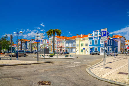 Aveiro, Portugal, June 13, 2017: round square in Aveiro city historical center with typical traditional colorful multicolored buildings houses, blue sky in sunny summer day background