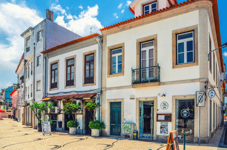 Aveiro, Portugal, June 13, 2017: typical colorful buildings in Aveiro city historical center in sunny summer day, blue sky background 新闻类图片