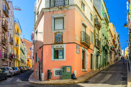 Lisbon, Portugal, June 15, 2017: crossroads of typical narrow streets with colorful multicolored traditional buildings and houses in Lisboa historical city center 新闻类图片