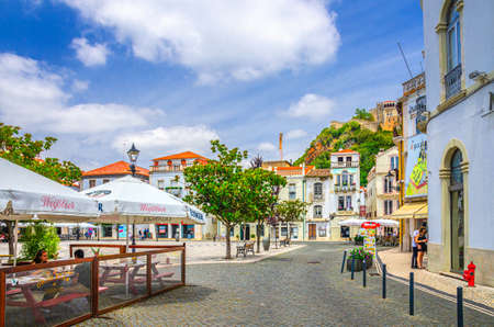 Leiria, Portugal, June 22, 2017: Praca Rodrigues Lobo square with typical traditional buildings, houses and street restaurant in Leiria city historical center