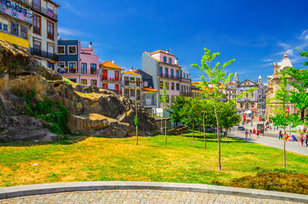 Porto, Portugal, June 23, 2017: colorful typical buildings and houses on stone rocks in historical city center in sunny summer day, blue sky background 新闻类图片