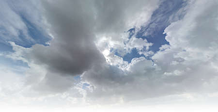 Gray cumulus clouds against a gentle blue sky. Wonderful skyline landscape.