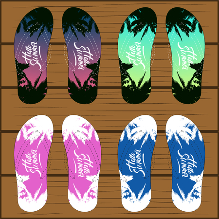Set of colored pattern flip flops with schemed strips isolated on wooden background