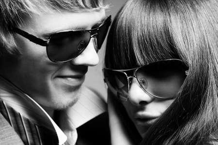 Fashionable young couple wearing sunglasses  photo