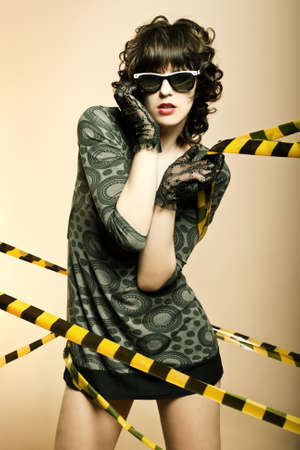 Fashion art portrait of a beautiful young sexy woman wearing sunglasses photo