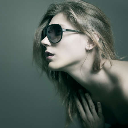 Fashion woman portrait wearing sunglasses photo