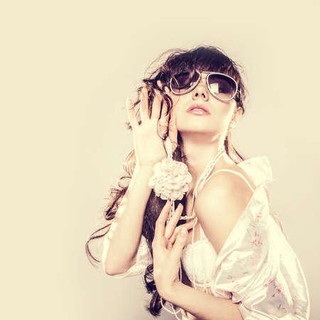 cool girl: Fashion portrait of a beautiful young sexy woman wearing sunglasses
