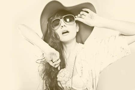 Fashion portrait of a beautiful young woman wearing sunglasses Stock Photo
