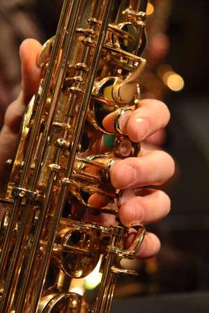 Saxophone close up of hand playing keys