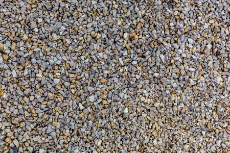 Close up of the gravel pattern. Background wall of rubble. The surface is covered with gravel. Stok Fotoğraf