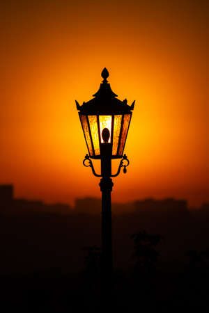 The dawn sun shining through the lantern. Фото со стока