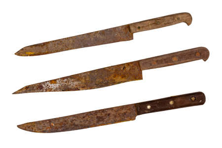 Three old rusty knives. Archaeological finds, ancient tools. Isolate, no background