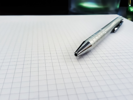 Notepad and pen at a meeting or conference