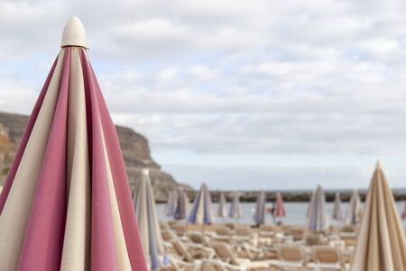 Pink-white Sunshade at the beach of Puerto Mogan, Gran Canaria in January or Winter