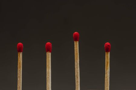 Group of matchsticks representing a team with a bad or great leader, fatigues employees